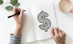 Photo of woman doodling about earning money